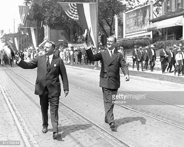 Democratic presidential candidate James Cox and his running mate Franklin Roosevelt campaign in a parade.