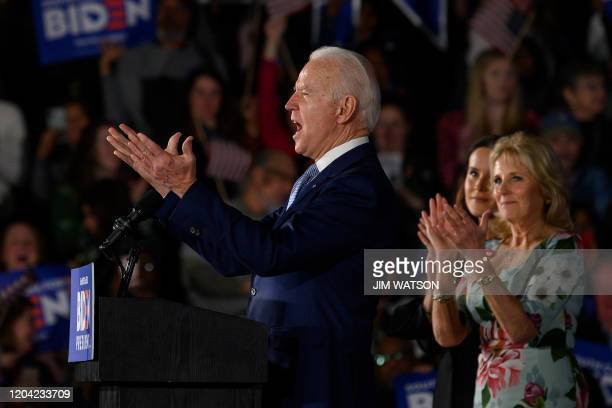 TOPSHOT Democratic presidential candidate Joe Biden accompanied by his daughter Ashley Biden and wife Jill Biden delivers remarks at his primary...