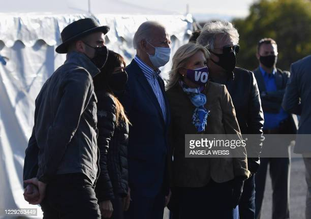 Democratic presidential candidate Joe Biden and his wife Jill biden pose with singer Jon Bon Jovi at a Drive-In rally at Dallas High School, in...