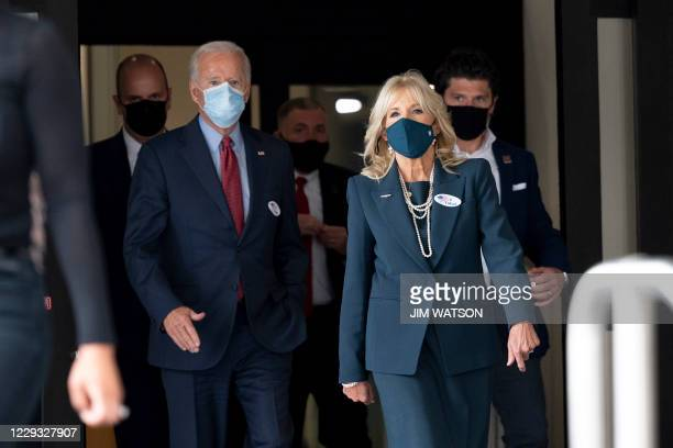 Democratic presidential candidate Joe Biden and his wife Jill Biden walk out of the state building after voting in Wilmington, Delaware, on October...