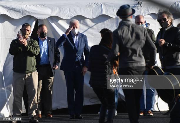 Democratic presidential candidate Joe Biden and singer Jon Bon Jovi attend a Drive-In rally at Dallas High School, in Dallas, Pennsylvania, on...