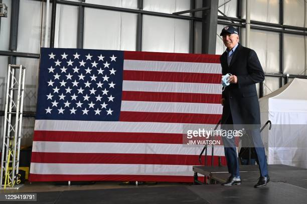 Democratic presidential candidate Joe Biden arrives to speak at a drive-in get out the vote event at Burke Lakefront Airport on November 2, 2020 in...