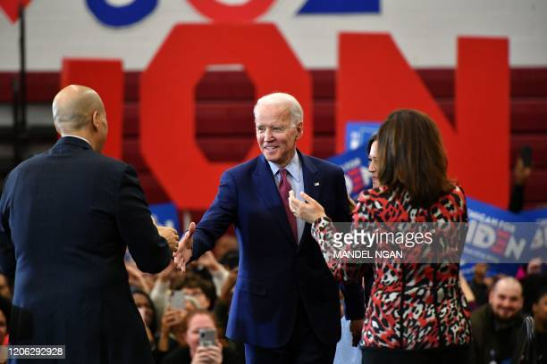 Democratic presidential candidate Joe Biden greets New Jersey Senator Cory Booker as California Senator Kamala Harris and Michigan Governor Gretchen...