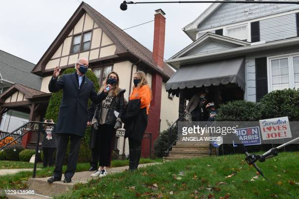 Democratic presidential candidate Joe Biden visits his childhood home with his granddaughters in Scranton, Pennsylvania on November 3, 2020. - The...