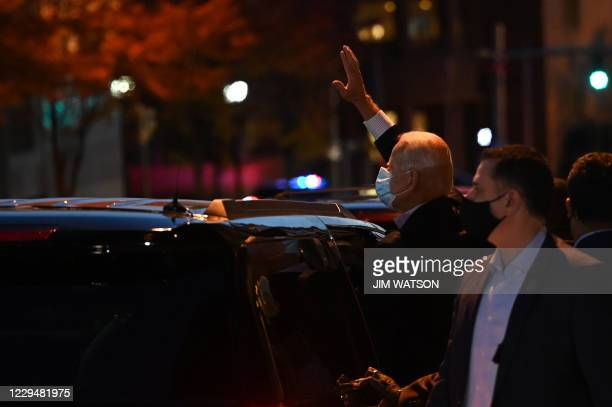 Democratic Presidential candidate Joe Biden waves as he leaves after speaking at the Queen venue in Wilmington, Delaware, on November 5, 2020. - The...