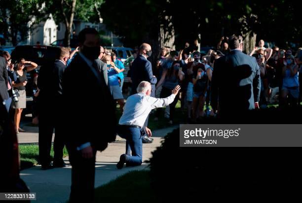 Democratic presidential candidate Joe Biden waves to supporters as he departs an event in Wauwatosa, Wisconsin on September 3, 2020. - Joe Biden met...