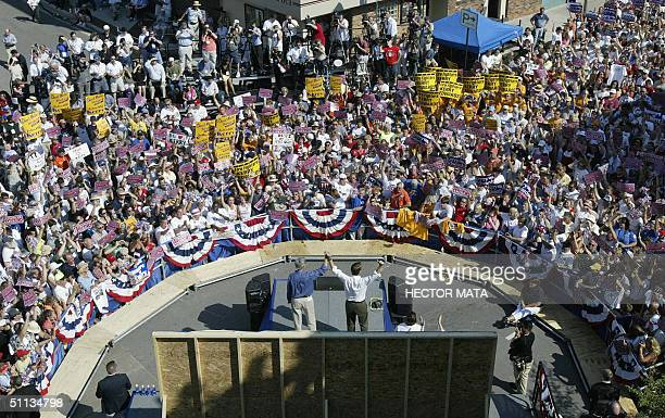 Democratic presidential candidate John Kerry and running mate John Edwards greet a crowd of supporters 01 August 2004 in Bowling Green OH AFP PHOTO /...