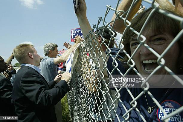 Democratic presidential candidate John Kerry greets a group of supporters during a stop 01 August 2004 on the way to Bowling Green OH AFP PHOTO /...