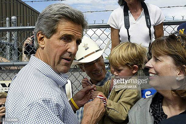 Democratic presidential candidate John Kerry meets a group of supporters in Twin Falls, Idaho, 17 August before getting into his plane to resume his...