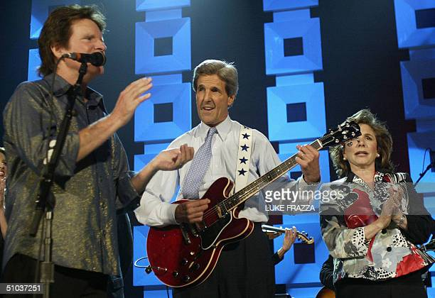 Democratic presidential candidate John Kerry plays a guitar appear at a Kerry/Edwards 2004 Victory concert at Radio City Music Hall in New York City...