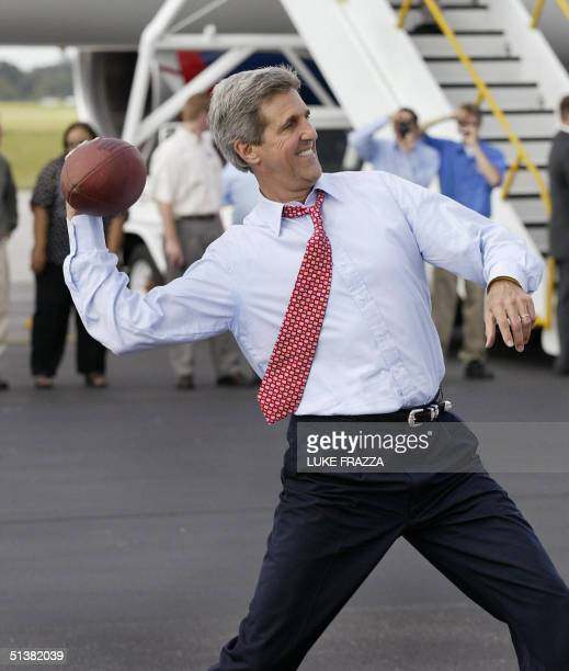 Democratic presidential candidate John Kerry plays football at Tampa International Airport in Tampa Florida 01 October 2004 Kerry is on a campaign...