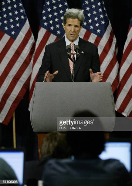 Democratic presidential candidate John Kerry speaks to reporters 22 July at the Cobo Center in Detroit, Michigan after he spoke at the 2004 National...