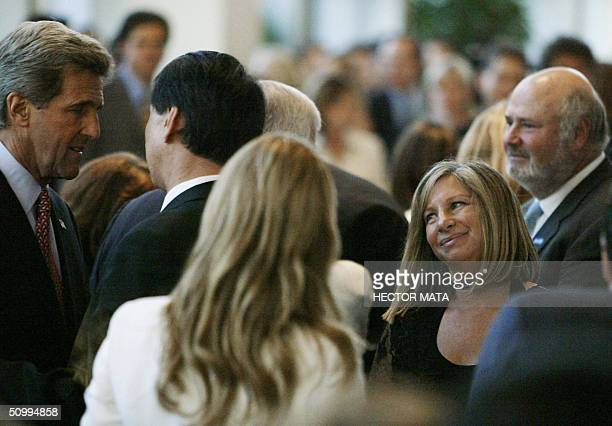 Democratic Presidential candidate John Kerry walks among Hollywood personalities Rob Reiner and Barbra Streisand during a fund raising event at the...
