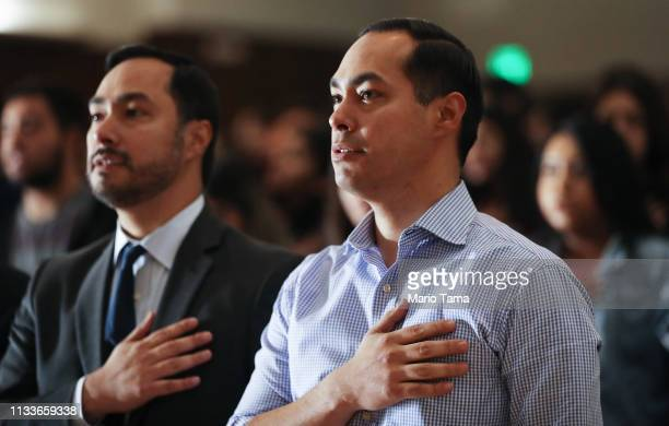 Democratic presidential candidate Julian Castro and his twin brother US Rep Joaquin Castro recite the 'Pledge of Allegiance' at Bell Gardens High...