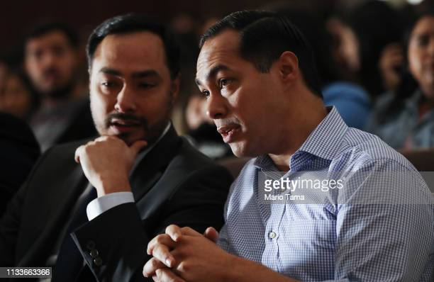 Democratic presidential candidate Julian Castro and his twin brother US Rep Joaquin Castro sit at a campaign appearance at Bell Gardens High School...