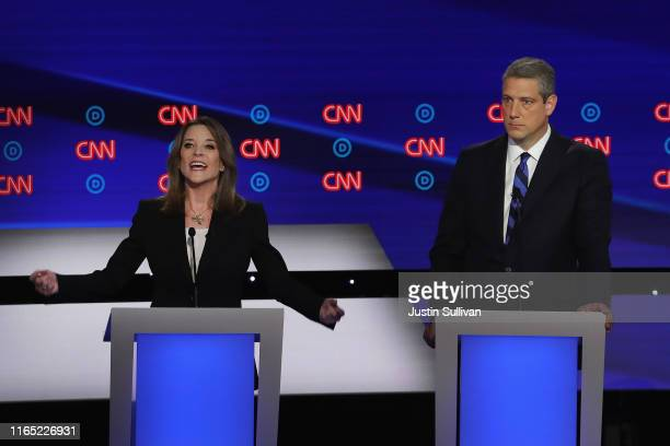 Democratic presidential candidate Marianne Williamson speaks while Rep Tim Ryan listens during the Democratic Presidential Debate at the Fox Theatre...