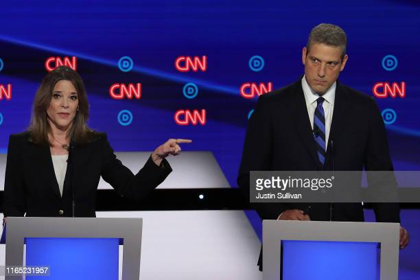Democratic presidential candidate Marianne Williamson speaks while Rep. Tim Ryan listens during the Democratic Presidential Debate at the Fox Theatre...