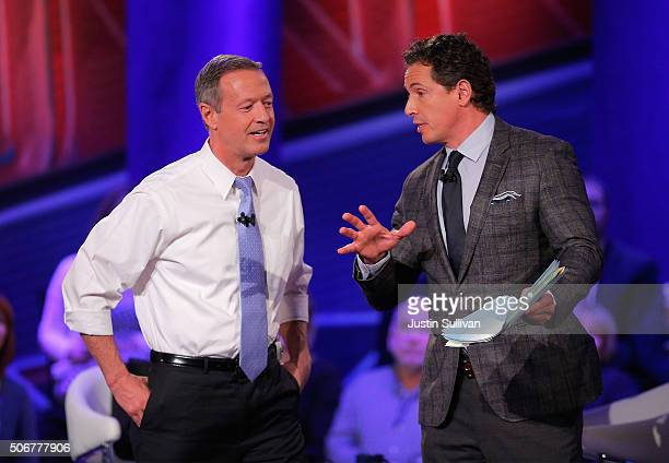 Democratic presidential candidate Martin O'Malley and moderator Chris Cuomo participate in a town hall forum hosted by CNN at Drake University on...