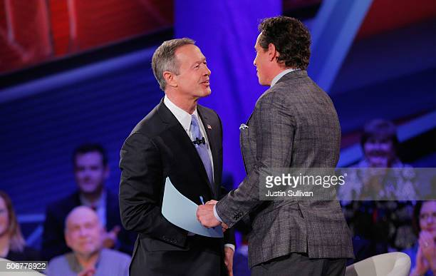 Democratic presidential candidate Martin O'Malley greets moderator Chris Cuomo during a town hall forum hosted by CNN at Drake University on January...