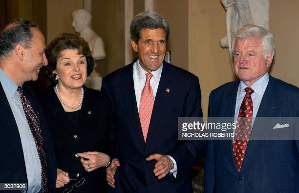 Democratic presidential candidate Massachusetts Senator John Kerry poses during a photoop with Senators Charles Schumer DNY Dianne Feinstein DCA and...