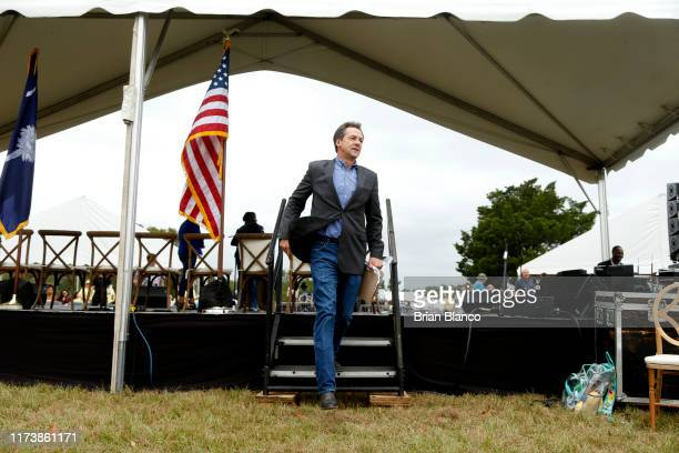 Democratic presidential candidate, Montana Gov. Steve Bullock exits the back of the stage after speaking to attendees at the Blue Jamboree on October...