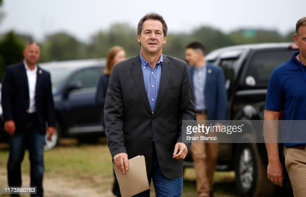 Democratic presidential candidate, Montana Gov. Steve Bullock makes his way to the stage to speak at the Blue Jamboree on October 5, 2019 in North...