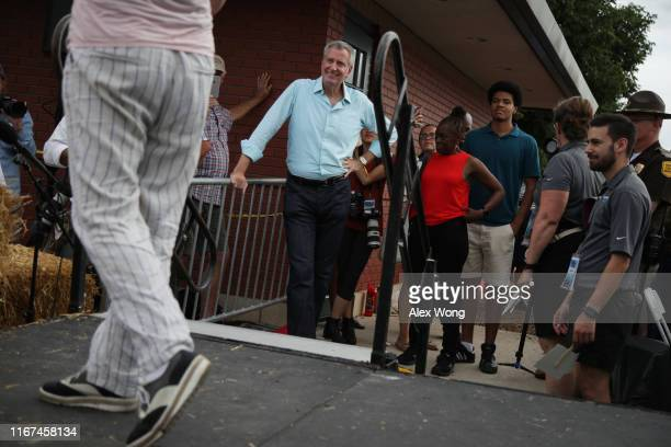 Democratic presidential candidate New York City Mayor Bill de Blasio his wife Chirlane McCray and his son Dante de Blasio wait to be introduced at...