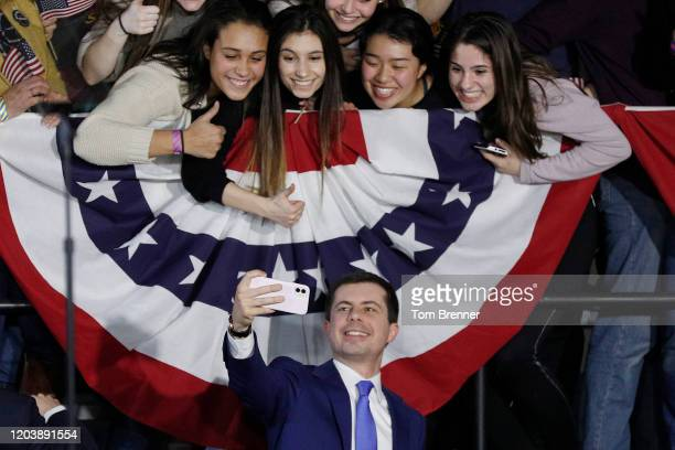 Democratic presidential candidate Pete Buttigieg takes a selfie with supporters after addressing his caucus night watch party on February 03, 2020 in...