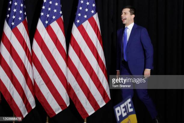 Democratic presidential candidate Pete Buttigieg takes the stage to address supporters during his caucus night watch party on February 03 2020 in Des...