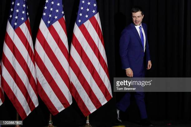Democratic presidential candidate Pete Buttigieg walks on stage before addressing supporters during his caucus night watch party on February 03 2020...