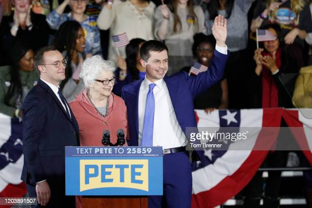 Democratic presidential candidate Pete Buttigieg waves with his husband Chasten Buttigieg and mom after addressing supporters at his caucus night...