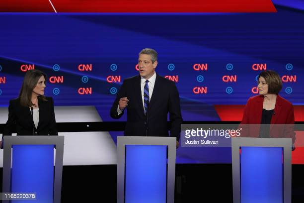 Democratic presidential candidate Rep. Tim Ryan speaks while Marianne Williamson and Sen. Amy Klobuchar listen at the of the Democratic Presidential...