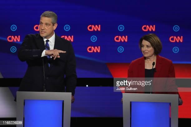 Democratic presidential candidate Rep Tim Ryan speaks while Sen Amy Klobuchar listens during the Democratic Presidential Debate at the Fox Theatre...