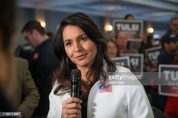 Democratic presidential candidate Rep Tulsi Gabbard answers media questions following a campaign event on February 9 2020 in Portsmouth New Hampshire...