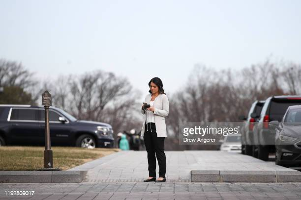 Democratic Presidential candidate Rep Tulsi Gabbard arrives at the US Capitol for the last votes of the week on January 10 2020 in Washington DC...