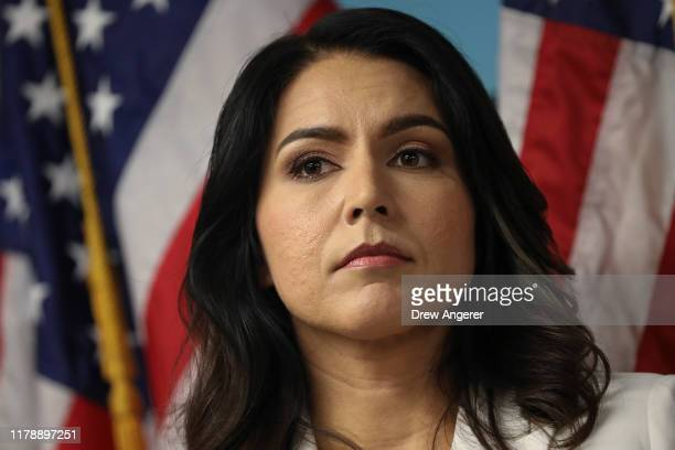 Democratic presidential candidate Rep Tulsi Gabbard looks on during a press conference at the 9/11 Tribute Museum in Lower Manhattan on October 29...