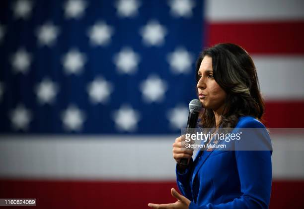 Democratic presidential candidate Rep Tulsi Gabbard speaks during a forum on gun safety at the Iowa Events Center on August 10 2019 in Des Moines...