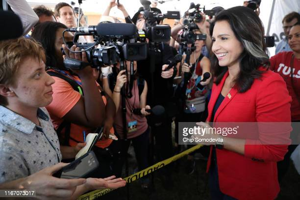 Democratic presidential candidate Rep Tulsi Gabbard talks to reporters during the Iowa State Fair August 09 2019 in Des Moines Iowa Twenty two of the...
