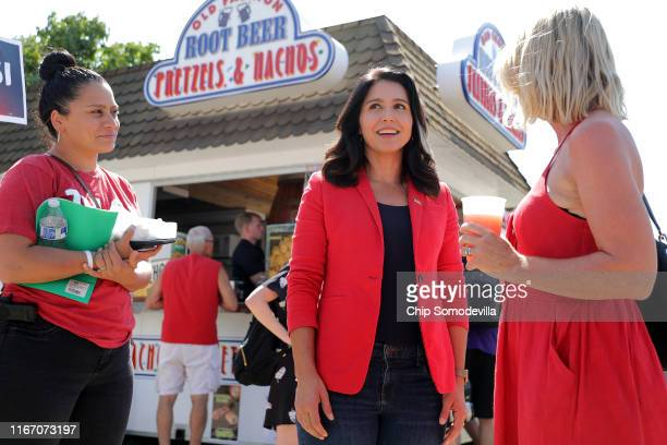 Democratic presidential candidate Rep Tulsi Gabbard talks with fairgoesr during the Iowa State Fair August 09 2019 in Des Moines Iowa Twenty two of...