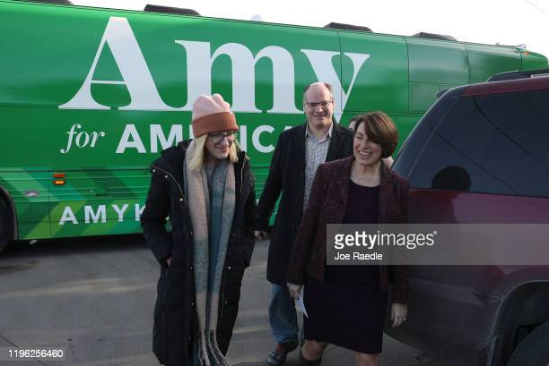 Democratic presidential candidate Sen Amy Klobuchar arrives with husband John Bessler and daughter Abigail Bessler for a campaign stop at Miller's...
