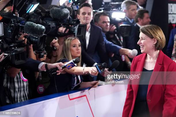 Democratic presidential candidate Sen Amy Klobuchar enters the spin room after the Democratic Presidential Debate at the Fox Theatre July 30 2019 in...