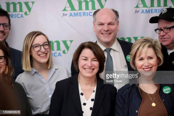 Democratic Presidential Candidate Sen Amy Klobuchar flanked by her husband John Bessler and daughter Abigail poses for a picture with guests during a...