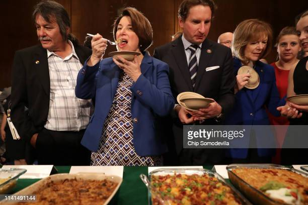 Democratic presidential candidate Sen Amy Klobuchar Rep Dean Phillips and Sen Tina Smith sample some of the entries in the ninth annual Minnesota...