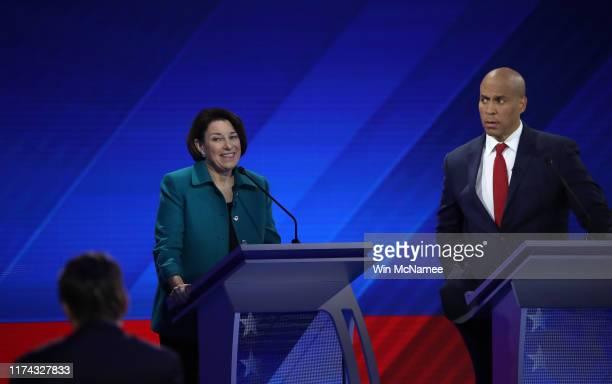 Democratic presidential candidate Sen. Amy Klobuchar speaks as Sen. Cory Booker looks on during the Democratic Presidential Debate at Texas Southern...