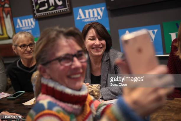 Democratic presidential candidate Sen Amy Klobuchar speaks to guests during a campaign stop at Timbukbru brew pub on November 26 2019 in Clarion Iowa...