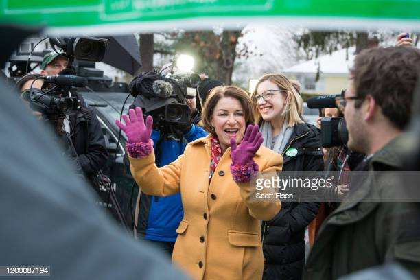Democratic presidential candidate Sen Amy Klobuchar waves to supporters while visiting the polling location at Webster Elementary School during the...