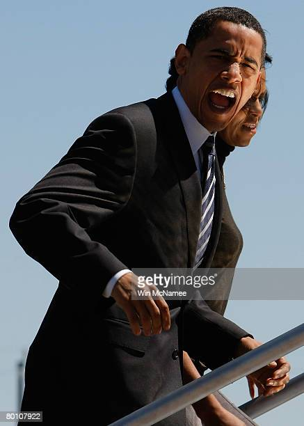 Democratic presidential candidate Sen Barack Obama and his wife Michelle board his campaign plance March 4 2008 in Houston Texas on their way to San...