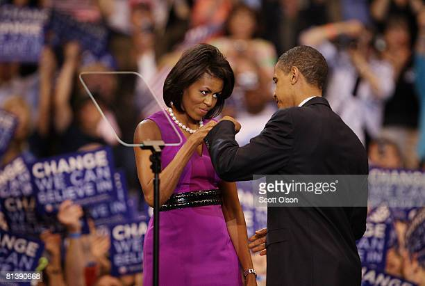 Democratic presidential candidate Sen Barack Obama and his wife Michelle Obama bump fists at an election night rally at the Xcel Energy Center June 3...