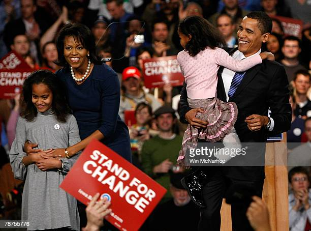 Democratic presidential candidate Sen Barack Obama holds his youngest daughter Sasha with his wife Michelle and daughter Malia while thanking...