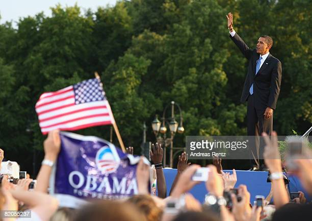 S Democratic presidential candidate Sen Barack Obama waves after he delivered his speech in front of the Siegessaeule on July 24 2008 in Berlin...